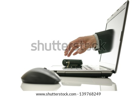 Hand coming out of laptop screen stealing wallet. Concept of internet theft. - stock photo