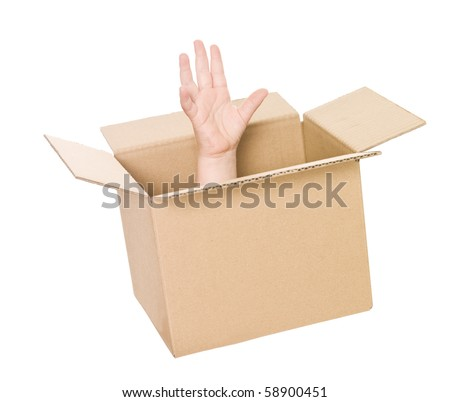 Hand coming up from a cardboard box isolated on white background - stock photo