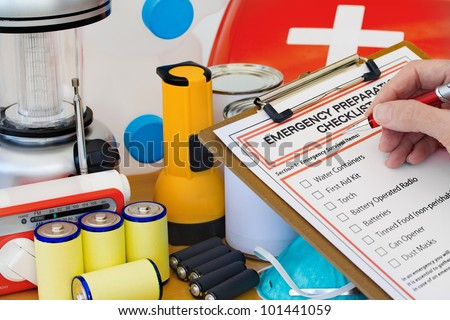 Hand completing Emergency Preparation List by Equipment - stock photo