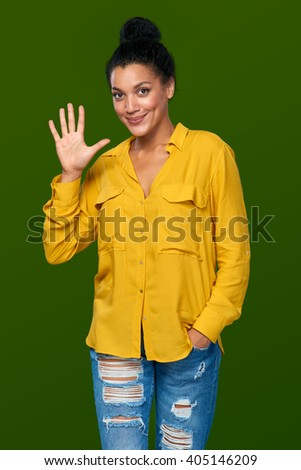 Hand counting - five fingers. Happy mixed race african american - caucasian woman showing five fingers - stock photo