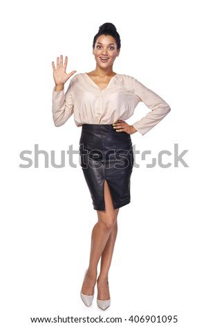 Hand counting - four fingers. Happy mixed race african american - caucasian woman showing four fingers standing in full length over white background - stock photo