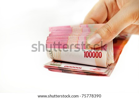 Hand counting indonesia money isolated