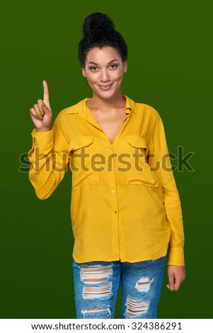 Hand counting - one finger. Happy mixed race african american - caucasian woman showing one finger, directing up - stock photo