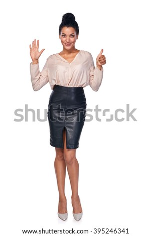 Hand counting - six fingers. Happy mixed race african american - caucasian woman showing six fingers standng in full length over white background - stock photo