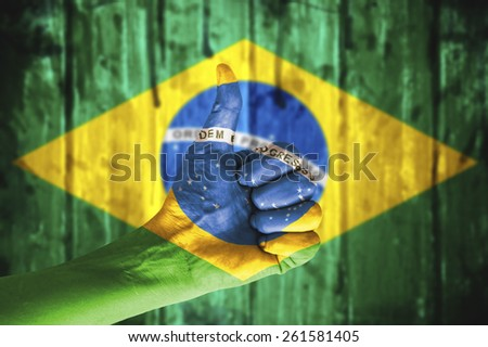 Hand covered in flag of Brazil. - stock photo