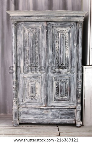 Hand crafted grey wooden wardrobe - stock photo