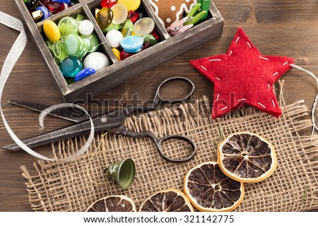 Hand crafted holiday ornaments and vintage scissors top view - stock photo