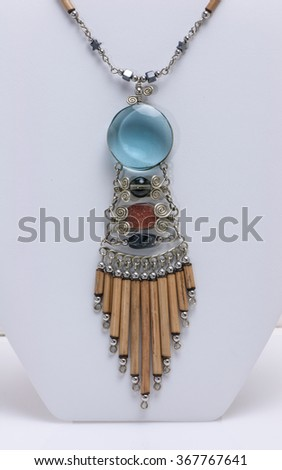 Hand Crafted Native American Necklace on White Background. Hand made indian necklace from tribe in Massachusetts.  This is a beautiful and unique piece of jewelry.  - stock photo