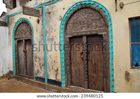 Hand crafted wooden door at Lamu Town, Lamu Island, Kenya - stock photo