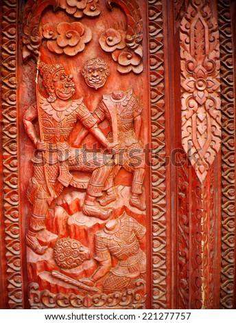 hand crafted work of THAI artist on a red brown hardwood temple door plate showing typical & Hand Crafted Work Thai Artist On Stock Photo (Download Now ...