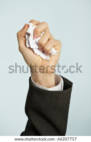 Hand crumples the paper - the hated work - stock photo