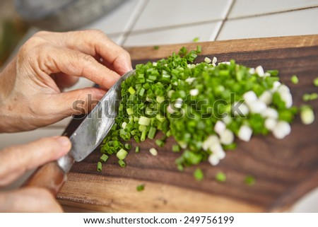 Hand cut scallion used as ingredient for cooking - stock photo
