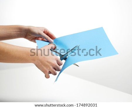 hand cutting paper - stock photo