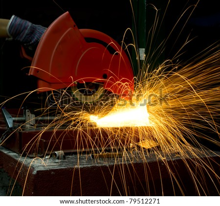 hand cutting steel - stock photo