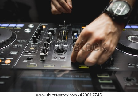 Hand detail of DJ on a mixer - stock photo