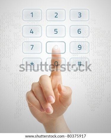 Hand dialling on holographic keypad using touch screen interface. - stock photo