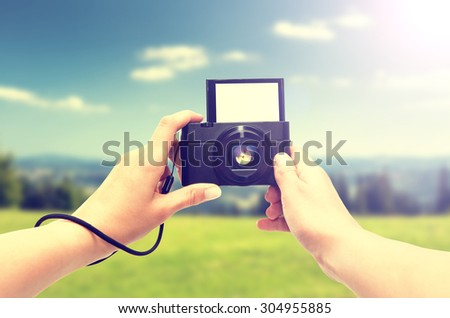 Hand digital camera isolated on white background. - stock photo