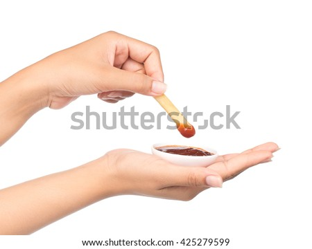 Hand dip french fries chips into ketchup isolated on white background - stock photo