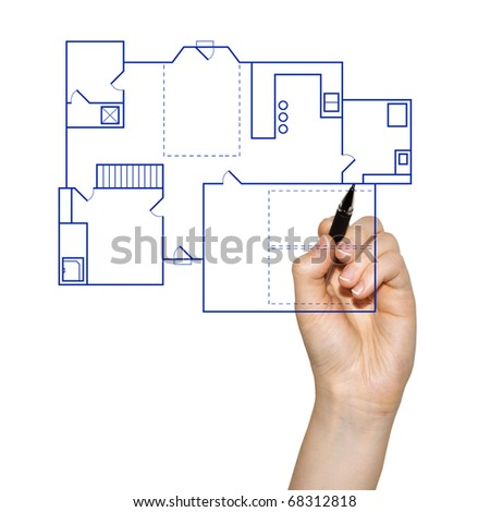 hand drafting a blueprint for a house - stock photo