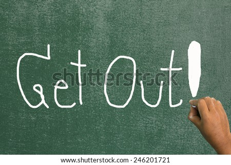 Hand draw at get out on chalkboard - stock photo