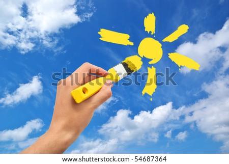 Hand draw the sun in sky. Conceptual design. - stock photo