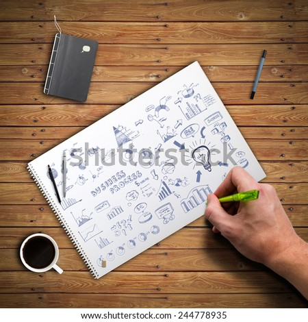 hand drawing a complicated business diagram - stock photo