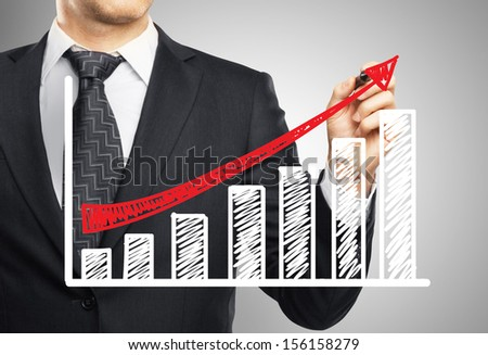 hand drawing arrow in office - stock photo