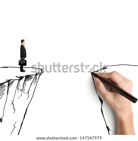 hand drawing businessman on rock - stock photo