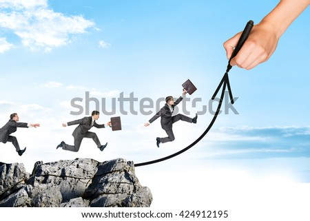 Hand drawing businessman running on arrow and rock on blue sky - stock photo