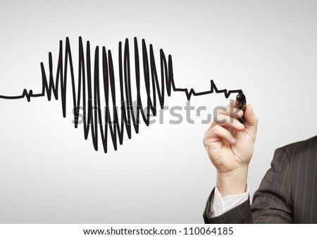hand drawing chart heartbeat on a white background - stock photo