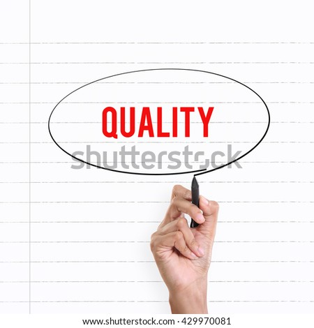 """Hand drawing circle around the note """"QUALITY"""", lined book page on the background - stock photo"""