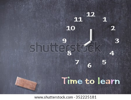 """Hand-drawing clock with text for """"Time to learn"""" on grungy chalk blackboard. - stock photo"""