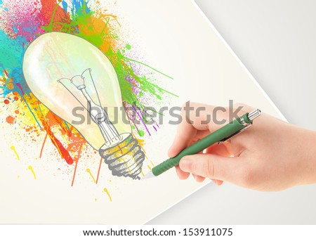 Hand drawing colorful idea light bulb with a pen on paper - stock photo