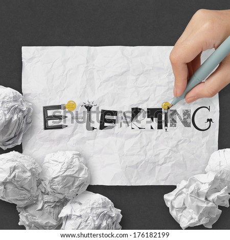 hand drawing design word E-LEARNING on dark crumpled paper and texture background as concept - stock photo