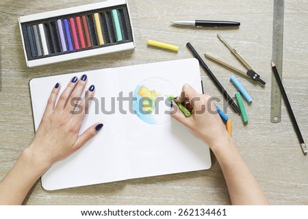 Hand drawing earth (globe) on notepad - stock photo