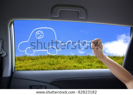 hand drawing Electric car concept on the car windows - stock photo