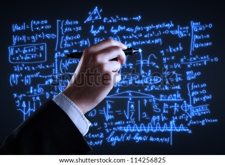 hand drawing formulas on a board - stock photo