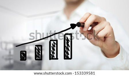 hand drawing graph in office - stock photo