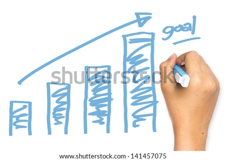 Hand drawing graph on whiteboard - stock photo