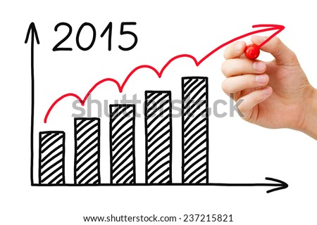 Hand drawing growth graph for year 2015 with marker on transparent wipe board. - stock photo