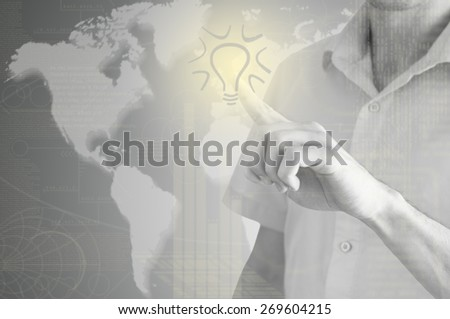 hand drawing light bulb on the virtual display. - stock photo