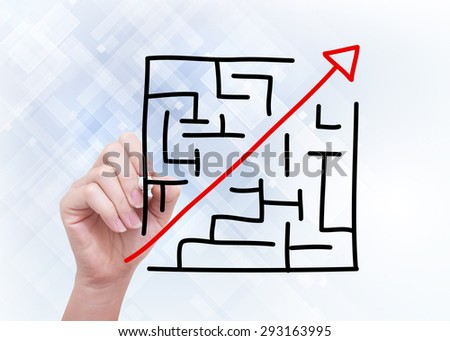 Hand drawing maze concept with black marker on transparent wipe board. - stock photo