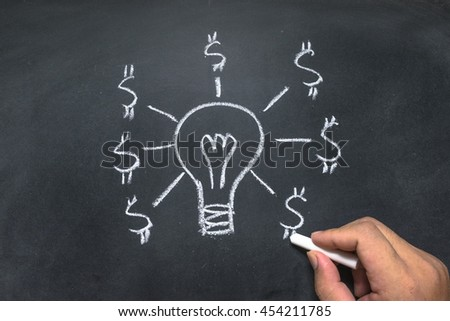 hand drawing of idea and money on the blackboard - stock photo