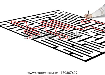 Hand drawing solution on maze in green background - stock photo