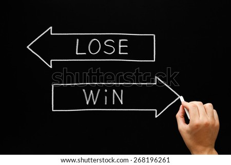 Hand drawing Win or Lose concept with white chalk on blackboard.  - stock photo