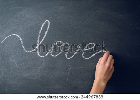 Hand drawing word love with chalk - stock photo