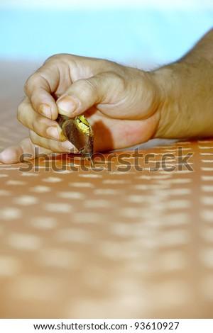 Hand drawn batik chanting on pure silk. - stock photo