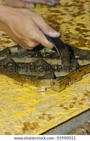 Hand drawn batik pressed using block on pure silk. - stock photo
