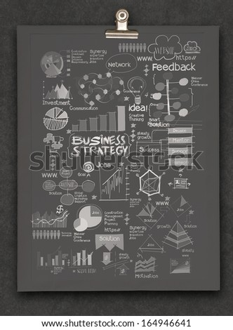 hand drawn business strategy on dark book background as concept - stock photo