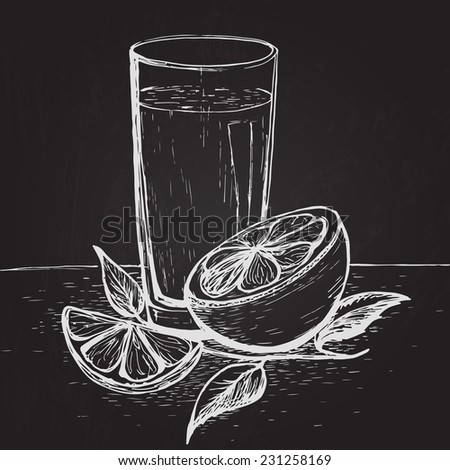 Hand drawn juice with slices of orange and leaves on the blackboard  - stock photo